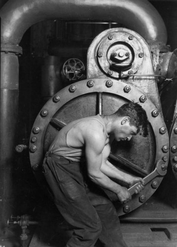 Lewis_Hine_Power_house_mechanic_working_on_steam_pump.jpg